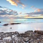 Dawn skies and ocean beach Jervis Bay NSW Australia